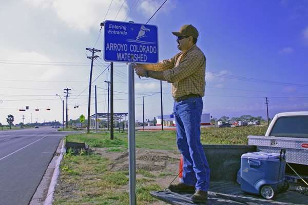 Agnews Photo Of Flores And Sign.Photo By Santa Ana